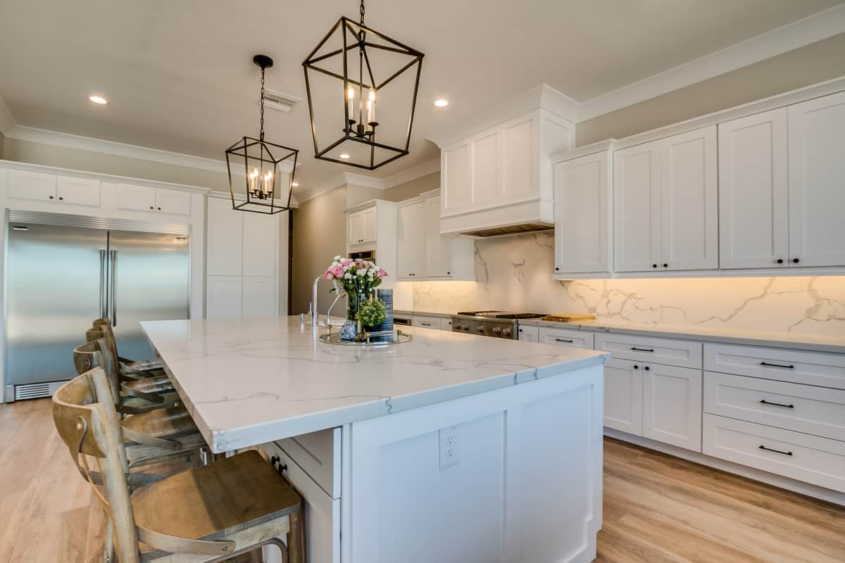 Kitchen cabinets with white countertop