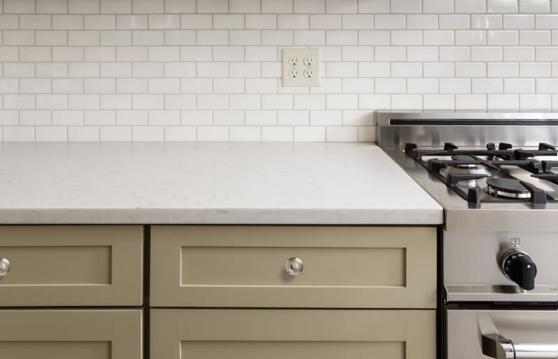 Kitchen Counter with Subway Tile, Stainless Steel oven stove, Shaker Cabinets